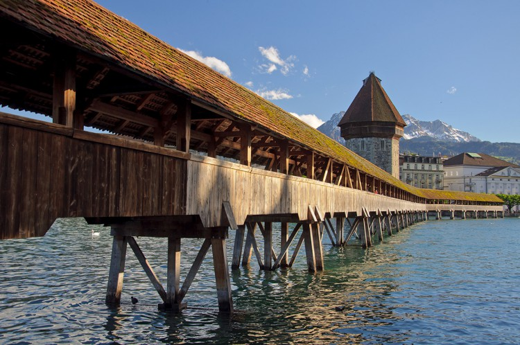 The Chapel Bridge is a covered wooden footbridge spanning diagonally across the Reuss River in the city of Lucerne in central Switzerland. The bridge contains a number of interior paintings dating back to the 17th century. The Kapellbrücke is the oldest wooden covered bridge in Europe.