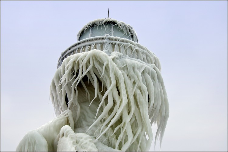 The St. Joseph, Michigan outer range light is covered in a thick layer of twisted ice following a winter storm that created 20 foot waves on Lake Michigan. The splashes from those waves created interesting ice patterns on the tower. As the wind changed direction during the storm, the ice began to twist.