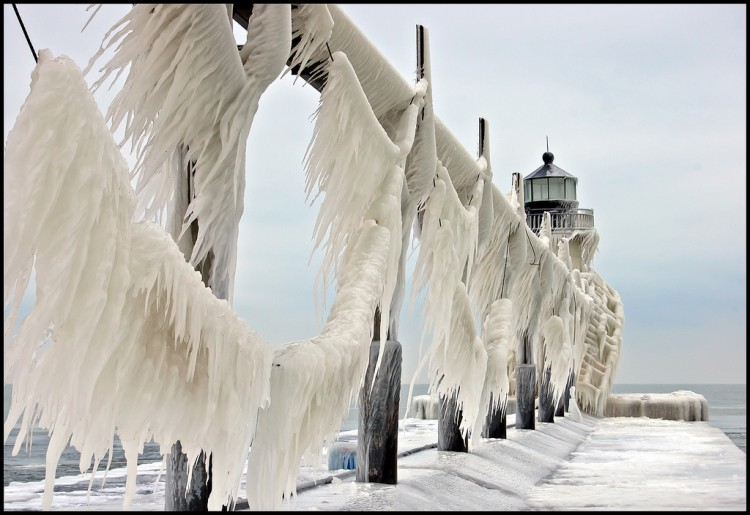 Ice formed on the St. Joseph, Michigan lighthouse and catwalk during a winter storm that churned up Lake Michigan and created 20 foot waves.