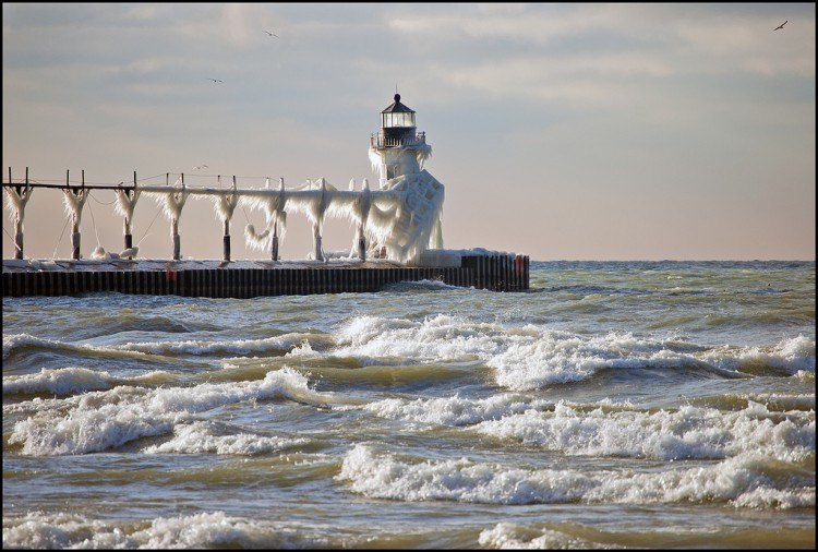 The sun finally appeared in St. Joseph late in the afternoon, highlighting the ice on the outer lighthouse.