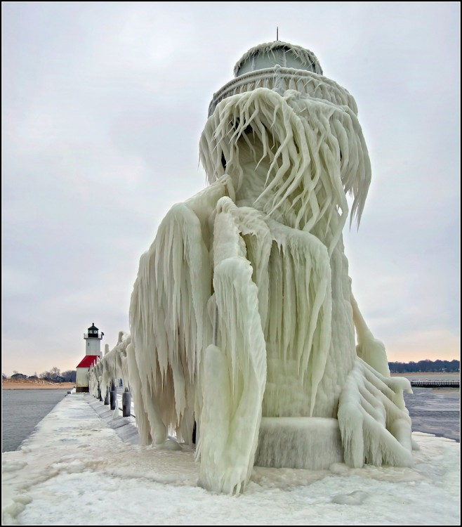The outer light of the St. Joseph, Michigan after a severe winter storm. Waves on Lake Michigan were said to be over 20 feet high, which pounded the lighthouse and covered it in ice feet thick in places. Workers were just finishing up a paint job when the storm hit. The scaffold was demolished and is also covered in a thick layer of ice. The walk to the lighthouse was treacherous- the pier is also covered in a layer of ice. Most of the way was slow going, but the walk next to the inner light was the most difficult. There is only a path about 20 inches wide with the lighthouse to your left, and the frigid lake to your right. I managed to carefully negotiate the path and make it out to the outer light. In hindsight, I'm lucky I didn't go for an unexpected winter swim.